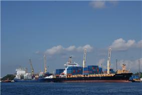 Large ship approaching a wharf
