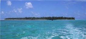 Photograph of the small, coral atoll of the island of Satawal in the Pacific Ocean.