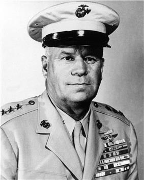 Head and shoulders of man in circa 1940 U.S. Marine khaki uniform, wearing many campaign ribbons.