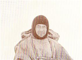 Man in winter coat wearing a balaclava or ski mask style headgear.