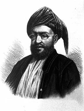 A black-and-white sketch of a man with a dark beard wearing glasses, a turban, a dark jacket, and a white shirt all in front of a white background