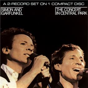 A man with curly hair, Art Garfunkel (left), and a shorter, smiling man, Paul Simon (right).