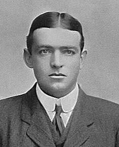 A young man wearing a tie, jacket and waistcoat.
