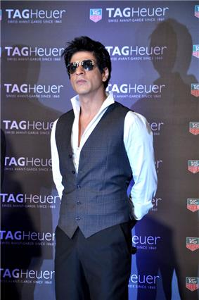 Shah Rukh Khan wearing sunglasses and a vest at a promotional event