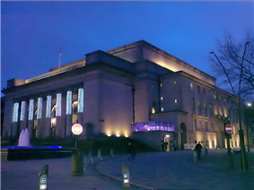 Sheffield City Hall, a Neo-classical design with a large portico and prominent pillars which were damaged when a bomb fell on the adjoining Barkers Pool during the Second World War. It is a grade II* listed building