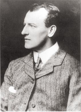 Young man in a suit, looking left