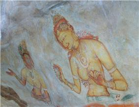 Painting on a rock face depicting two women, one dark skinned and the other fair skinned. Both are wearing jewellery and flowers, and both figures appear to be hidden in clouds below the waist.