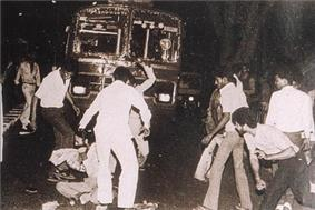 Sikh man being surrounded and beaten