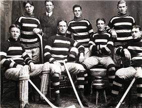Team in uniform, wearing horizontally striped sweaters