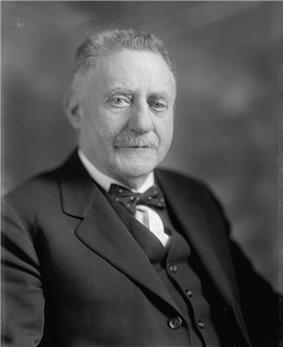 Upper-body portrait of an early-twentieth-century man in a suit.