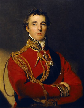 Portrait of a clean-shaven man in a red military uniform with his arms folded.