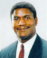 African American man with short hair and a short mustache
