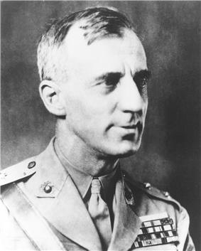 Head and shoulders of man in his 40s wearing a U.S. Marine uniform with ribbons, circa 1920.