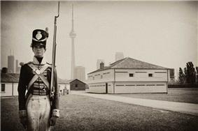 Exterior photo of an interpreter dressed as a soldier at Fort York