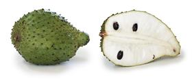 soursop fruit, whole and in section. It is green with scales has white flesh and black seeds