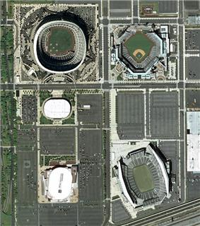 The South Philadelphia Sports Complex as it existed in 2003-2004.  Clockwise from top right: Citizens Bank Park, Lincoln Financial Field, Wells Fargo Center (formerly the site of John F. Kennedy Stadium), the Spectrum (razed in 2011), and Veterans Stadium (imploded in 2004). Interstate 95 can be seen running through the bottom right corner of the photo.