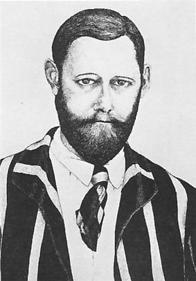 head and shoulders portrait of a middle-aged man with a beard wearing a striped jacket