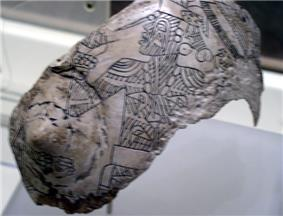 An engraved shell from the Spiro Site, with a tattooed figure