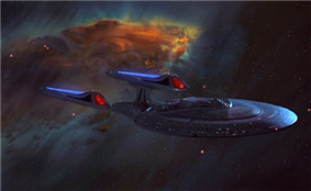 A spaceship glides out of a vibrant, multicolored nebula. The ship is composed of a saucer-shaped primary hull, connected to a thicker secondary hull. Paired glowing engines are attached to the secondary hull via swept-back struts.