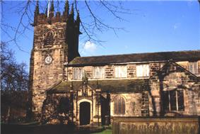 A stone Gothic church with a pinnacled tower