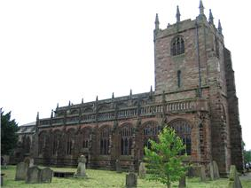 A Gothic stone church with a tower on the right