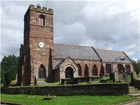 A stone Gothic church with a battlemented tower