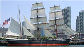 Photograph of the Star of India at dock as a museum ship in San Diego