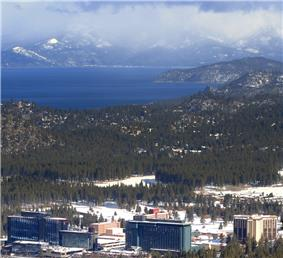 View of Stateline from a nearby mountain where Heavenly Mountain Resort is. Casinos in foreground, Lake Tahoe in background.