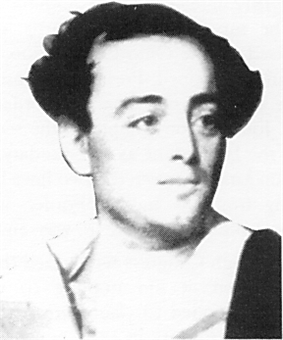 A black and white photograph of a young man
