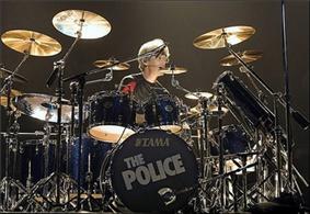 Copeland behind a drum kit