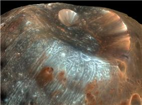 Enhanced-color view of the crater Stickney