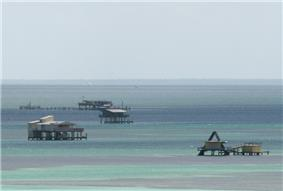 Buildings on pilings in the shallow water of Biscayne Bay