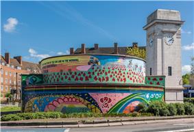 Round air-raid shelter, with a colourful mural