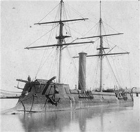 Large warship, seen from the prow, with protuding ram.