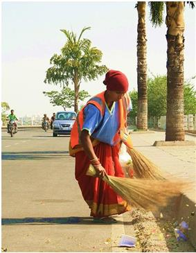 A woman sweeping the road