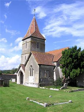 Stone church with red tiled roofs.
