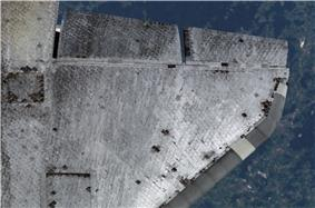 Grey spacecraft wing at aircraft altitude