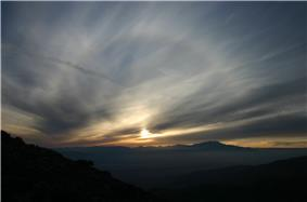 A picture of a solar halo shown as the fun sets