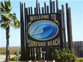The entrance sign to Surfside Beach