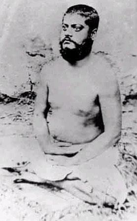 Image of Vivekananda, sitting in meditative posture, eyes opened