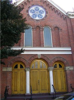 The red brick front facade of the synagogue