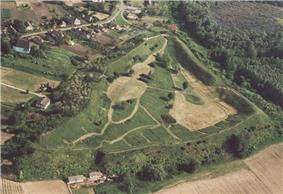 A piece of land surrounded by earthwork covered by trees
