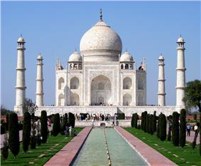 The Taj Mahal is a mosque-like structure of white marble with an onion-shaped dome, and a tall marble minaret at each corner