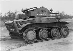 The side and rear of a Tetrarch light tank, with trees in the background