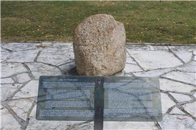 Image of the Tecumseh Stone, and accompanying plaque, at Fort Malden; Tecumseh reportedly stood on the stone to address British troops after the Battle of Lake Erie