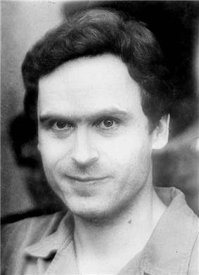 A monochrome photograph of a man with piercing eyes