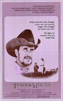 A movie poster with a large picture of a bearded man wearing a cowboy hat, suspended in the background of a photo of a much smaller scaled woman and young boy talking in a field. A tagline beside the man reads