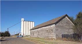 Grain elevator in New Mexico, wooden building in Texas