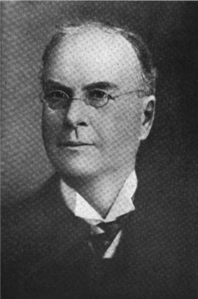 A black and white photographic portrait of Thayer Melvin in his later years.