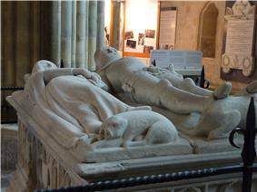 The tomb of the Earl and Countess of Arundel in Chichester Cathedral, which is topped by a life-size sculpture of the couple. An unusual feature of the sculpture is central to Larkin's poem